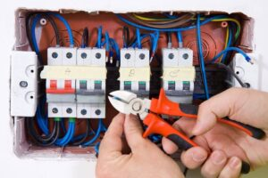 Electrical Switchboard with hand holding Wirecutters