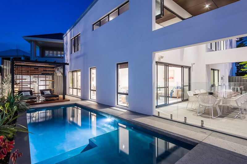 view of pool and well-lit home