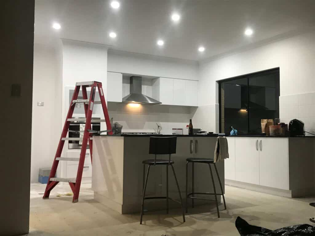 Electrical services being performed in a domestic kitchen